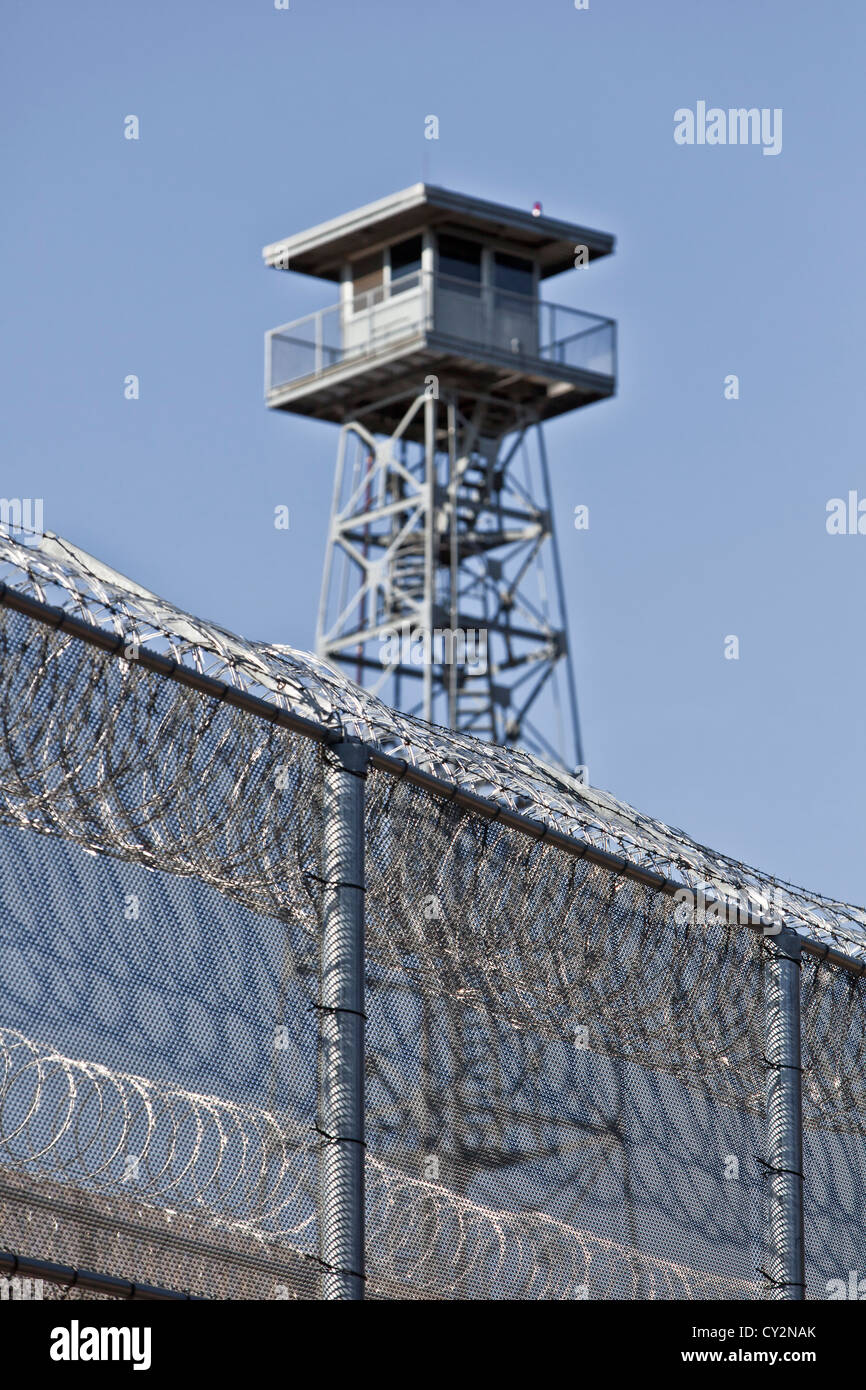 Security fence & tower, prison facility. - Stock Image