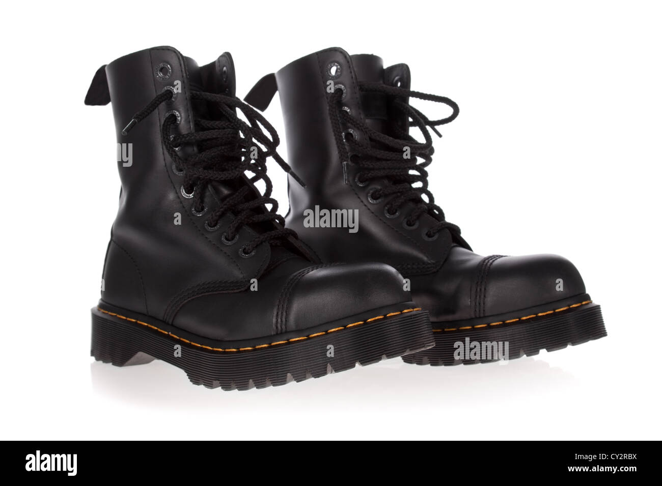 Military style black boots isolated on white background - Stock Image