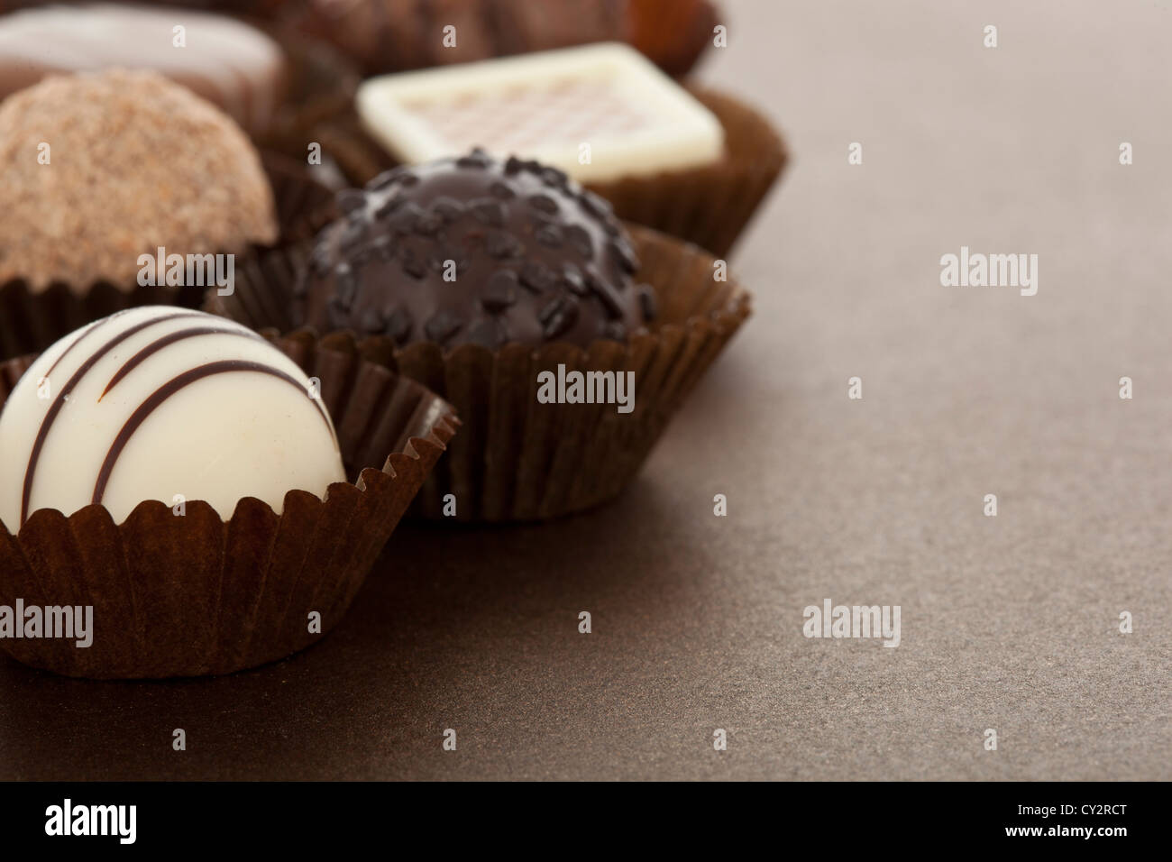 Assorted gourmet chocolate bonbons in paper cups - Stock Image