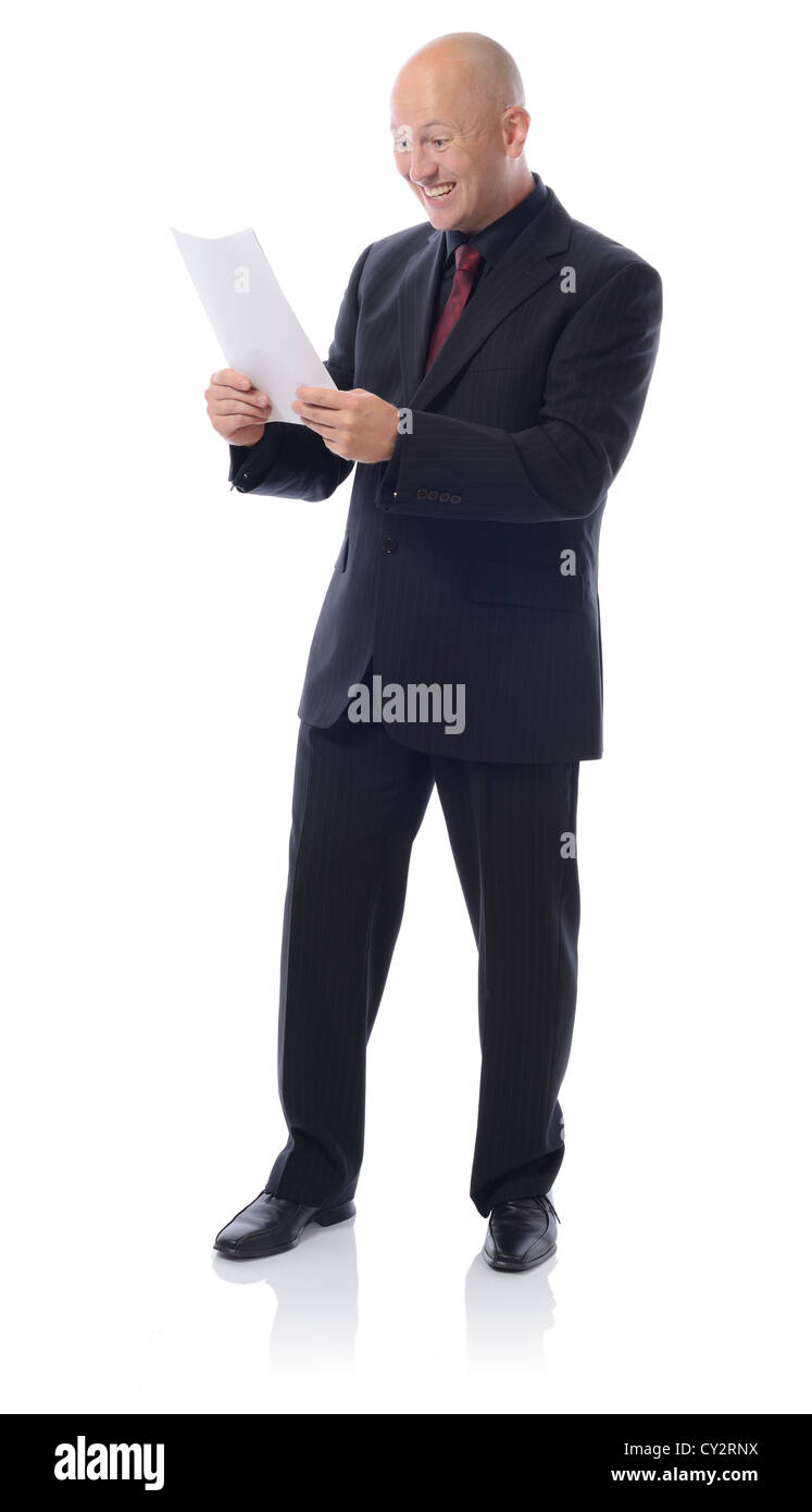 Man in suit with a letter receiving good result or news isolated on white - Stock Image