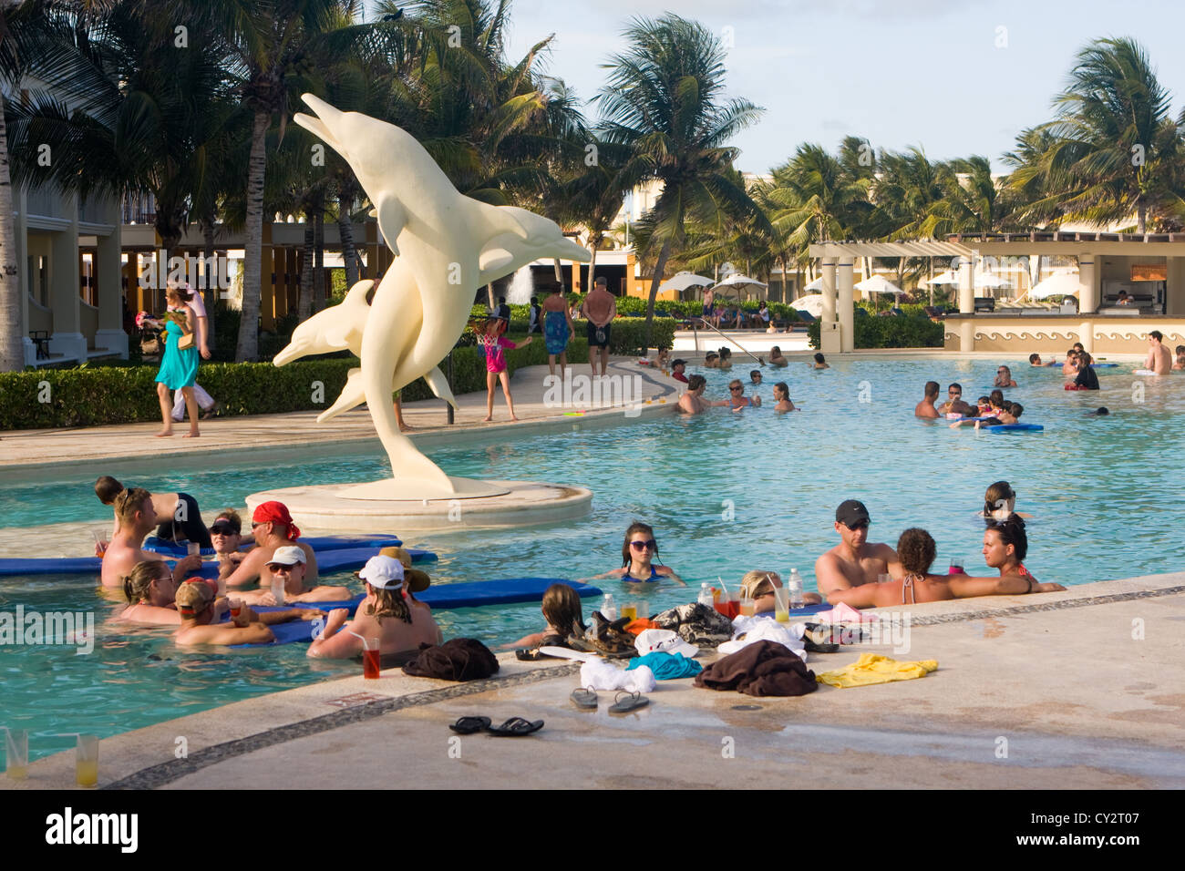 Hotel pool with people  Groups of people in a hotel swimming pool, Mexico Stock Photo ...