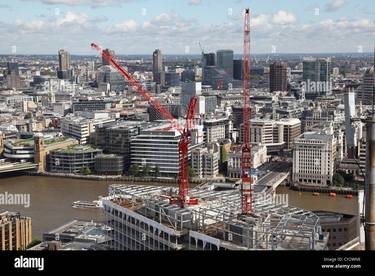 Tower cranes on the construction site at London Bridge Place south of the River Thames in London - Stock Image