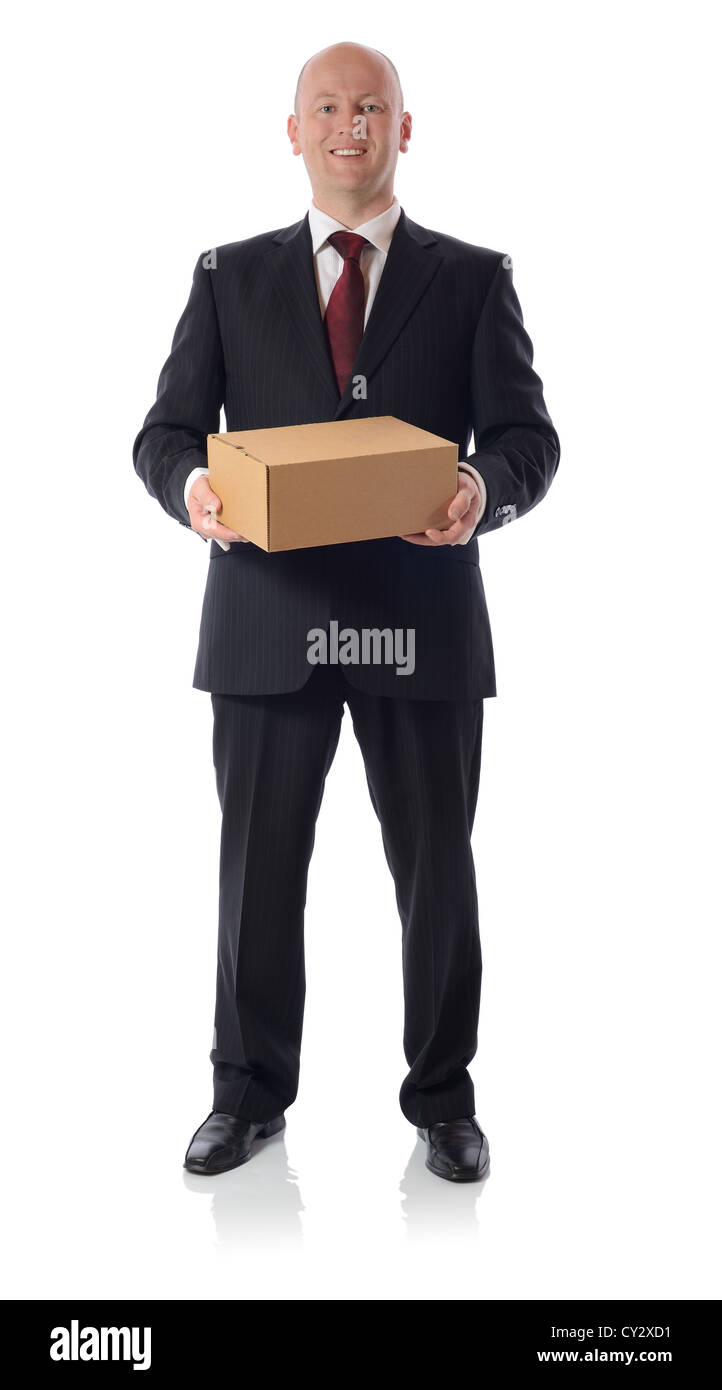 man in suit presenting a cardboard box parcel isolated on white - Stock Image