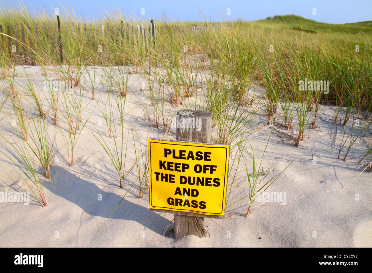 Massachusetts Cape Cod Nauset Beach Cape Cod National Seashore dune grass sign keep off sand - Stock Image