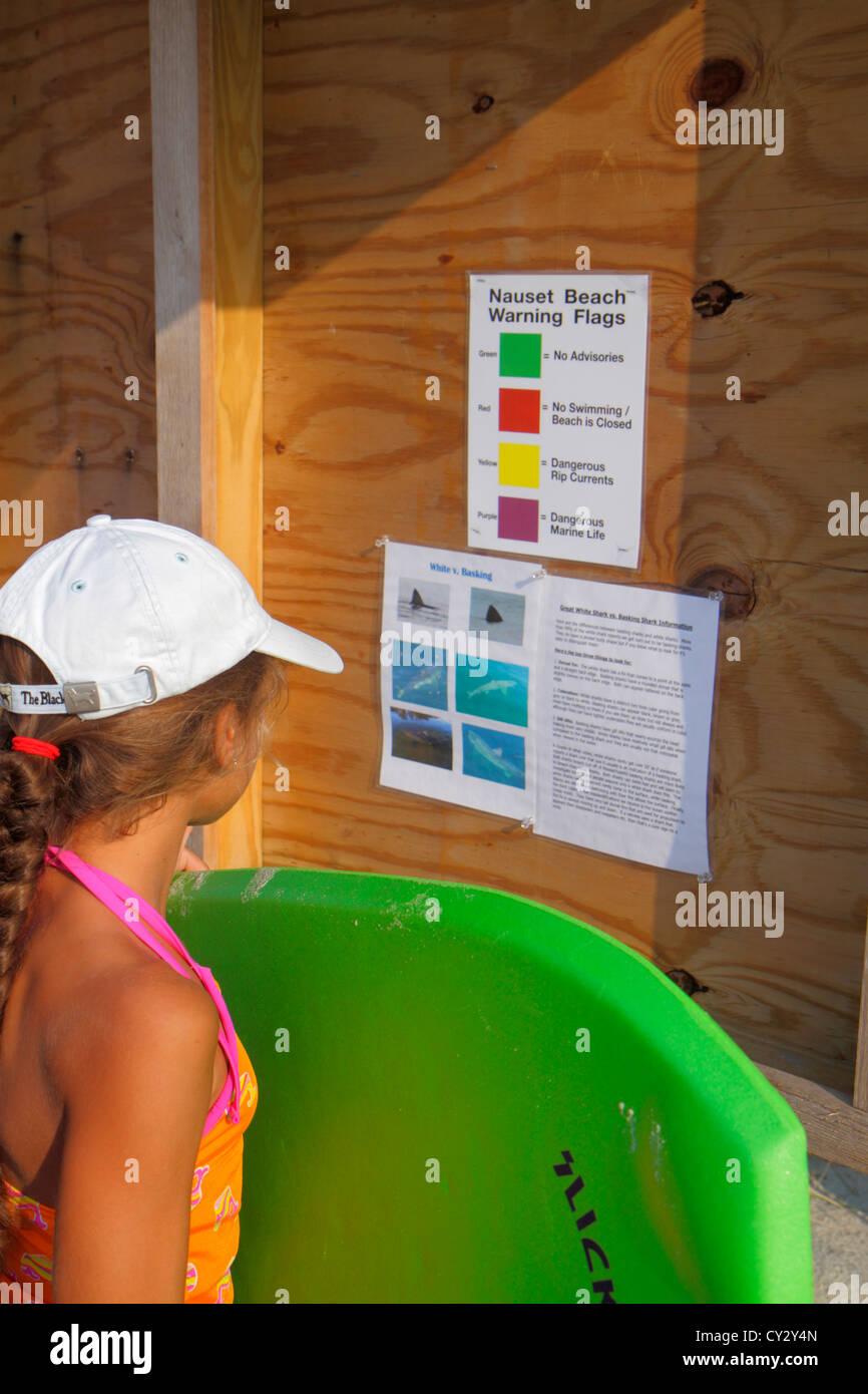 Massachusetts Cape Cod Nauset Beach Cape Cod National Seashore girl warning flag colors information - Stock Image
