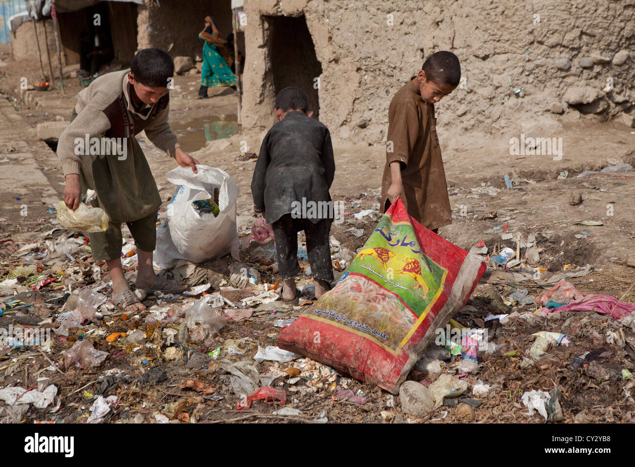 many children earn an income bt collecting plastic among rubbish, Kabul, - Stock Image