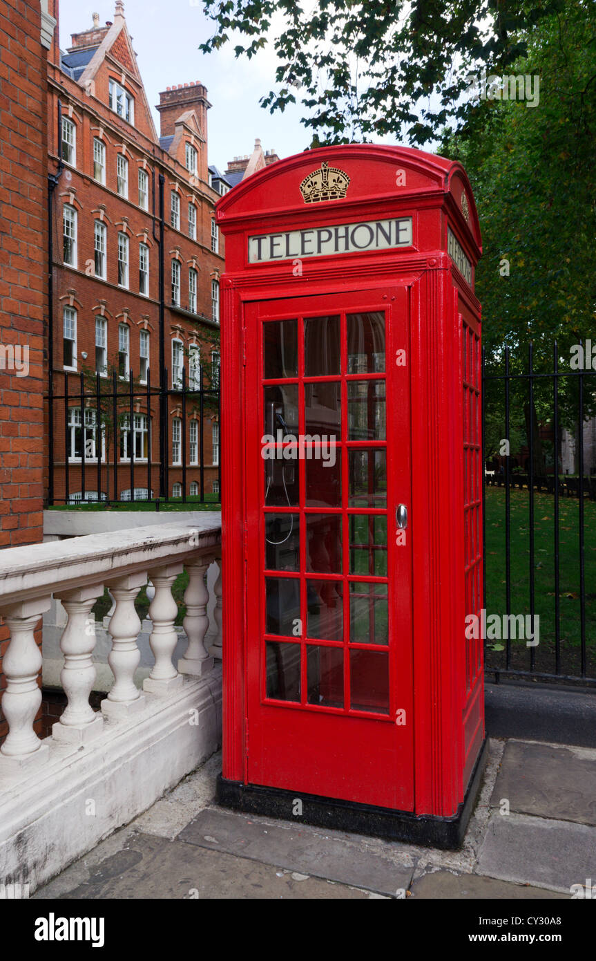 Red telephone box in Chapel Place, Mayfair, London. - Stock Image
