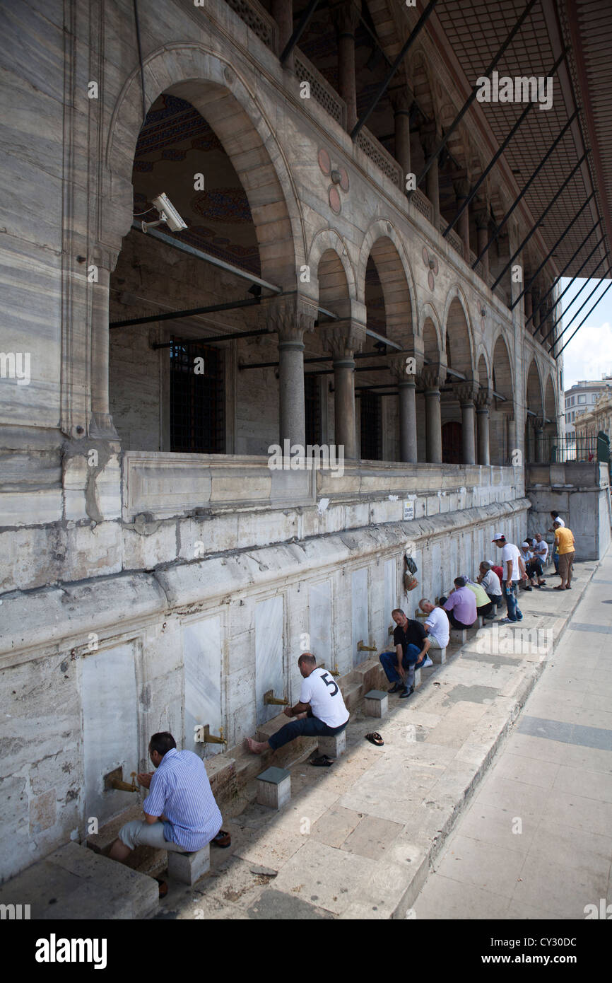 washing feet before entering the 'new mosque' in Istanbul - Stock Image
