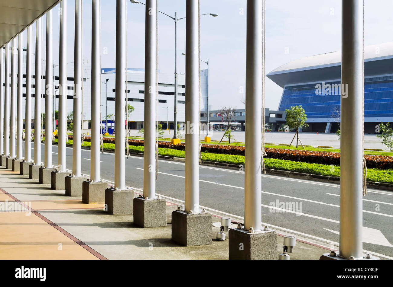 image country office. A Line Of Flag Poles On The Sidewalk - Stock Image Country Office R