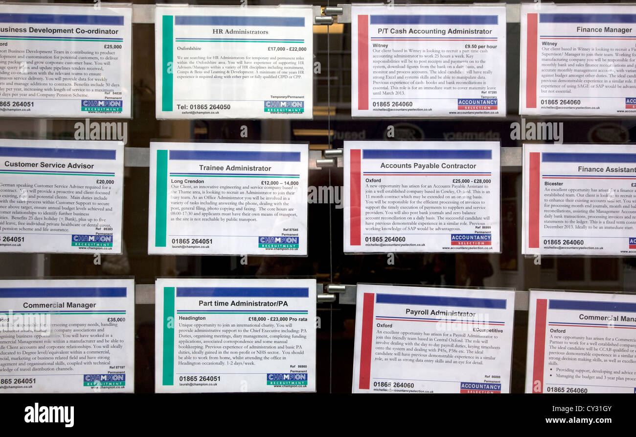 Jobs advertised in employment agency window, Oxford - Stock Image