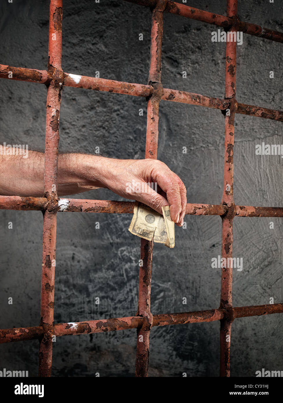 Conceptual image about bribery and corruption in prisons. - Stock Image