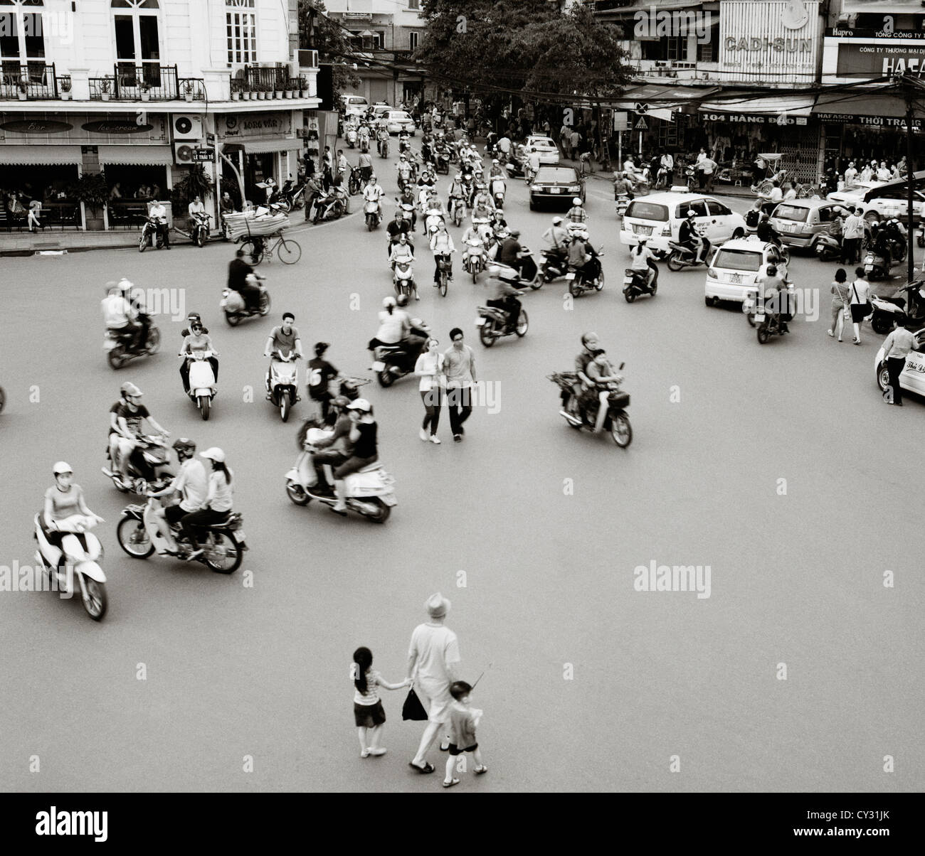 Road and street traffic in the Old City of Hanoi in Vietnam in Far East Southeast Asia. Modern Jam Congestion Scooter - Stock Image