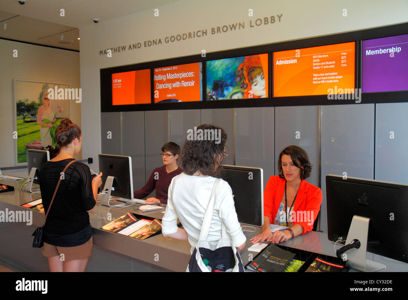 Boston Massachusetts Huntington Avenue Museum of Fine Arts lobby admissions desk ticket purchase woman - Stock Image