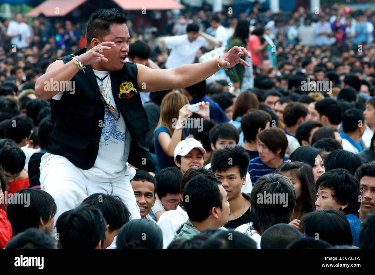Thai Man from audience in Trance, Wai Khru Tattoo Festival, Wat Bang Phra, Nakhon Pathom Province, Thailand. credit: - Stock Image