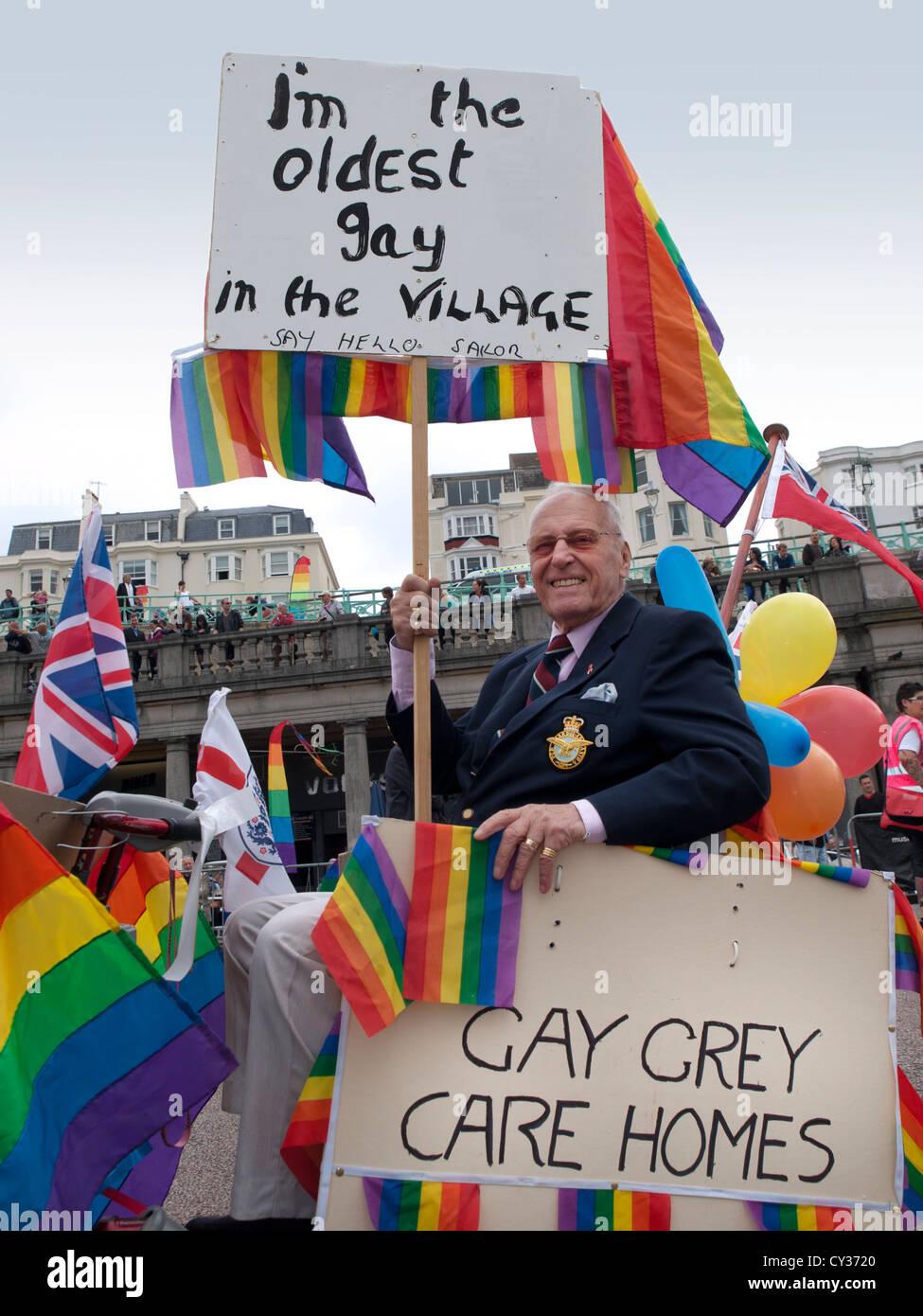 An old gay man in a motorised wheelchair at Brighton Pride 2012.