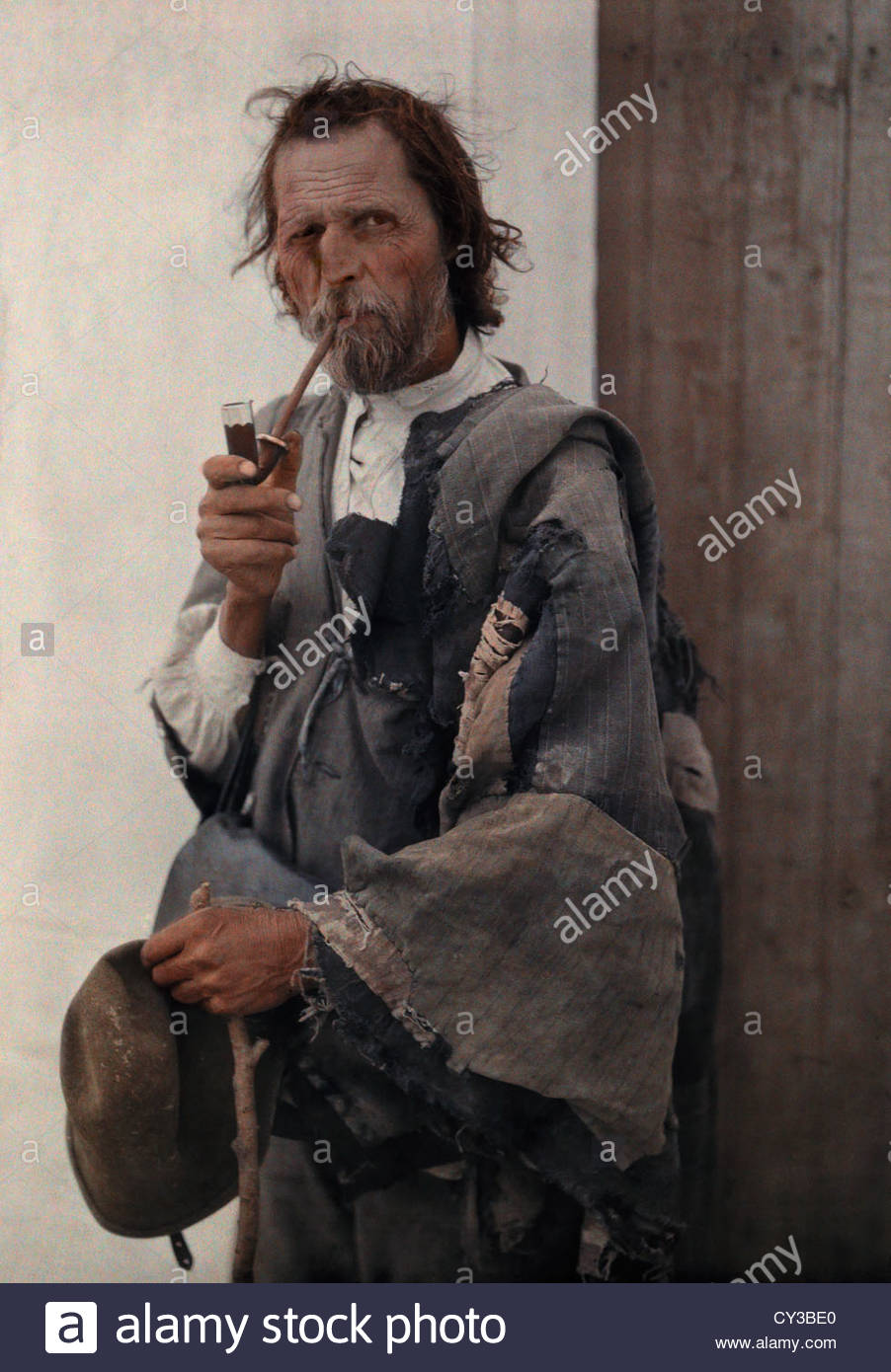 Portrait of a gypsy man smoking a pipe. Stock Photo