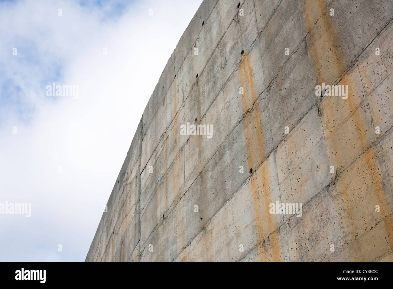 A High Concrete Retaining Wall With Drainage Holes And