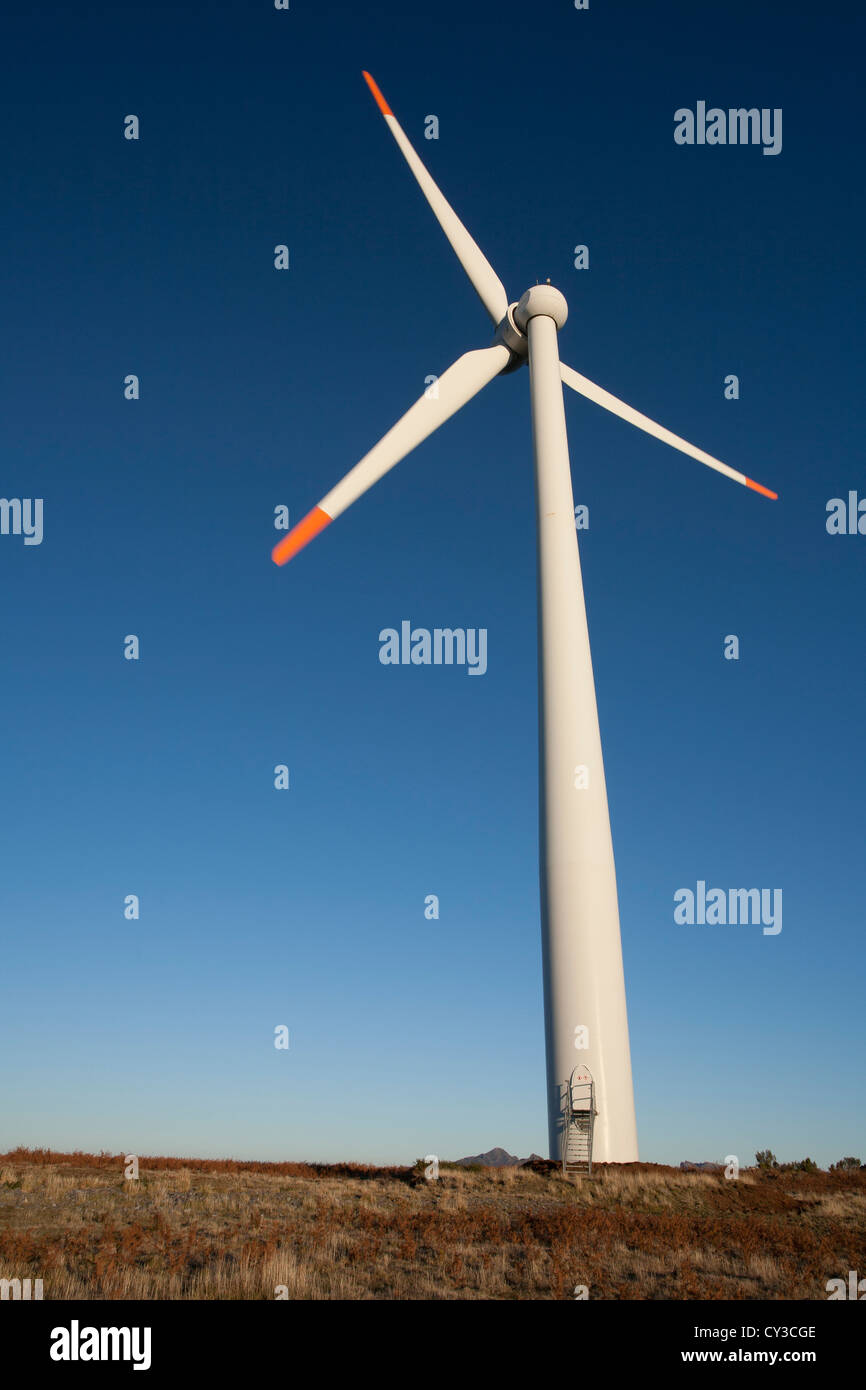 A Vensys 77 gearless wind turbine on a mountain with a deep blue, clear sky background. - Stock Image