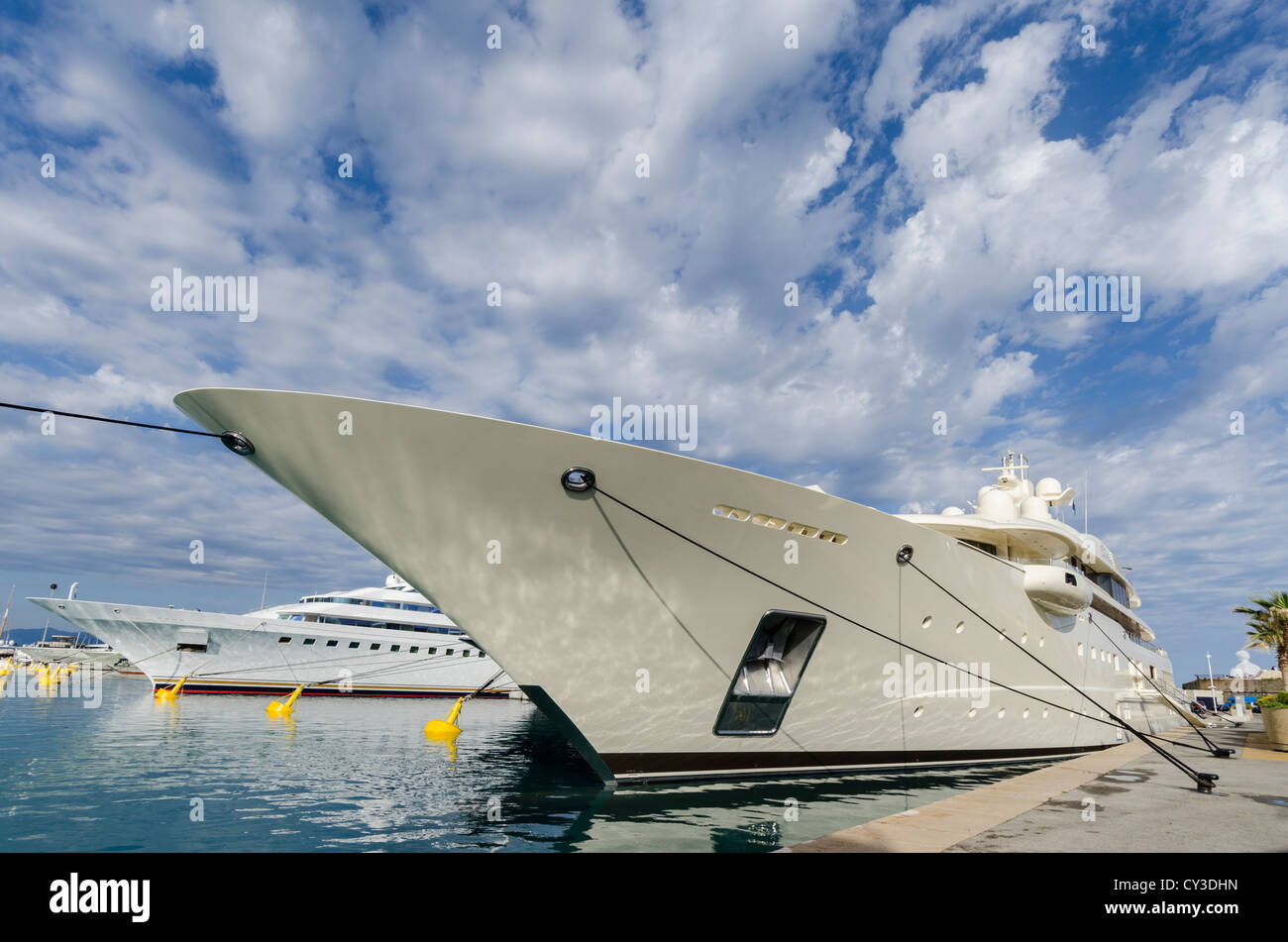 The Dilbar and other luxury yachts anchored in Antibes harbour, Cote d'Azur, France. - Stock Image