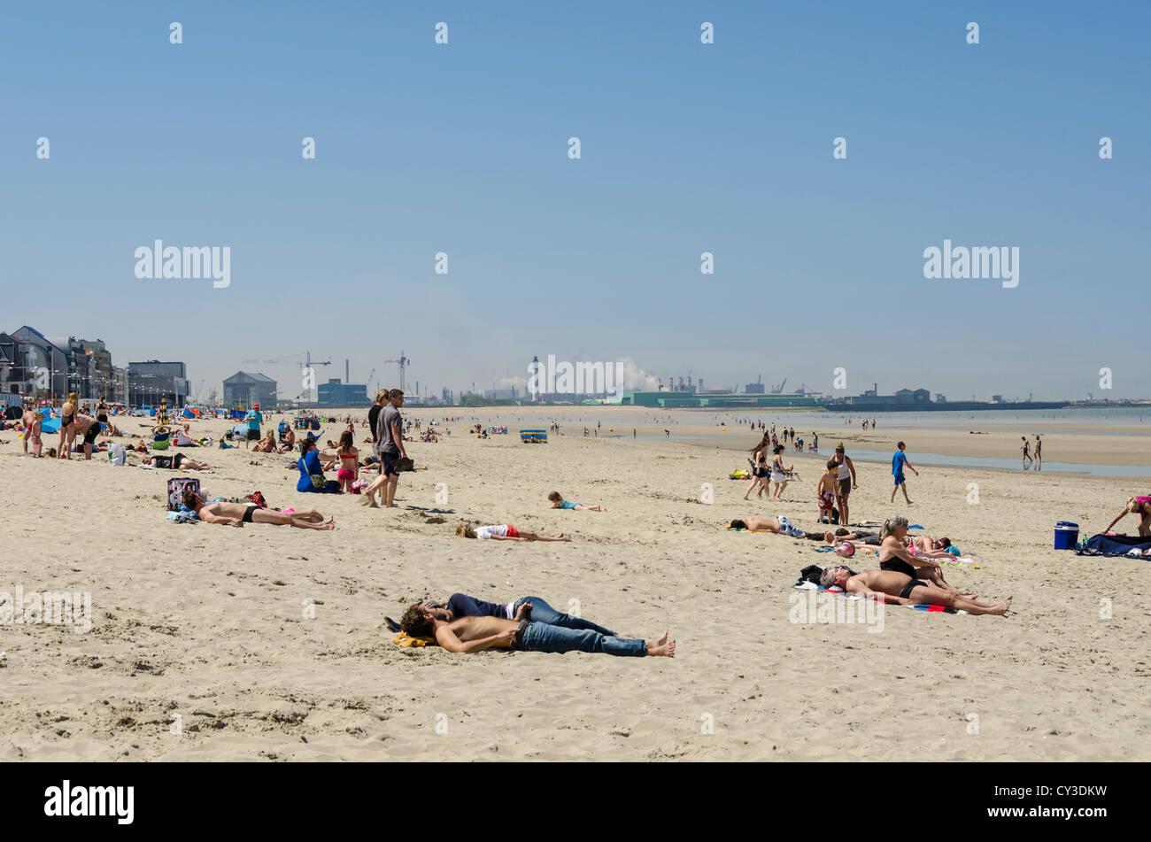 Sunbathers on Dunkirk beach, Northern France - Stock Image
