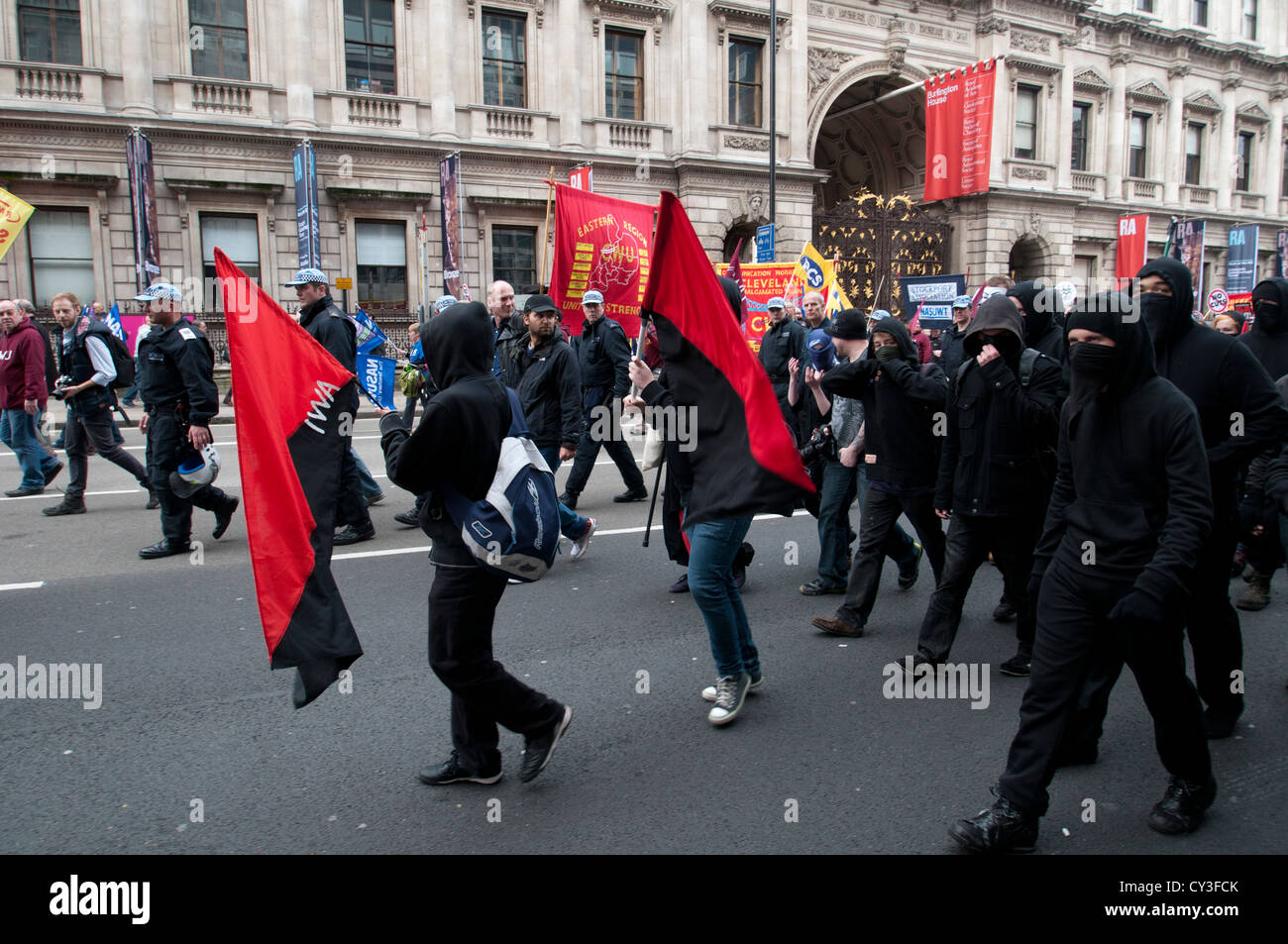 TUC March -- 20 October 2012 -- Protesters marched from Embankment to Hyde Park. Anarchists are amongst the march. - Stock Image