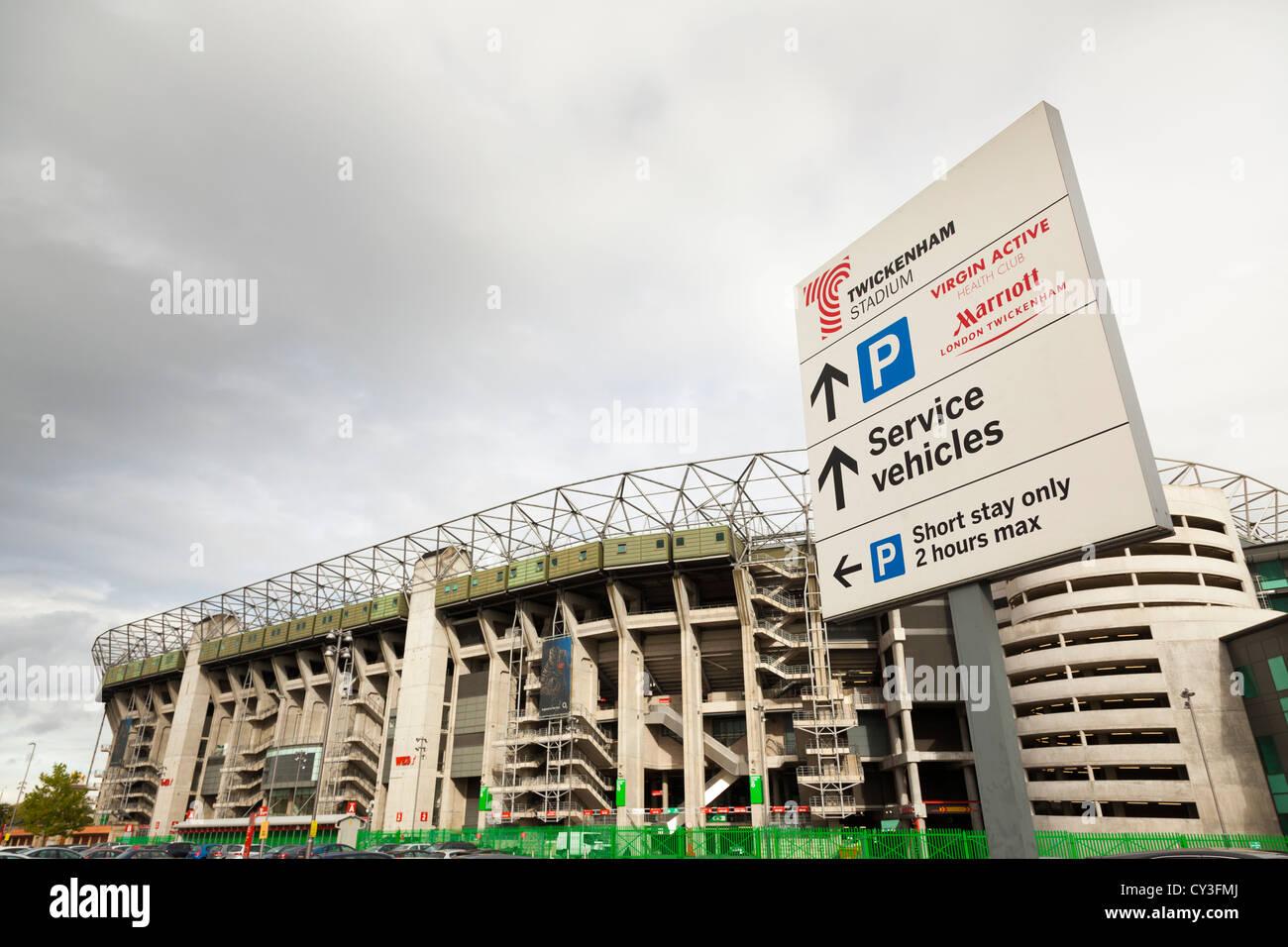 Twickenham stadium with parking information sign. - Stock Image