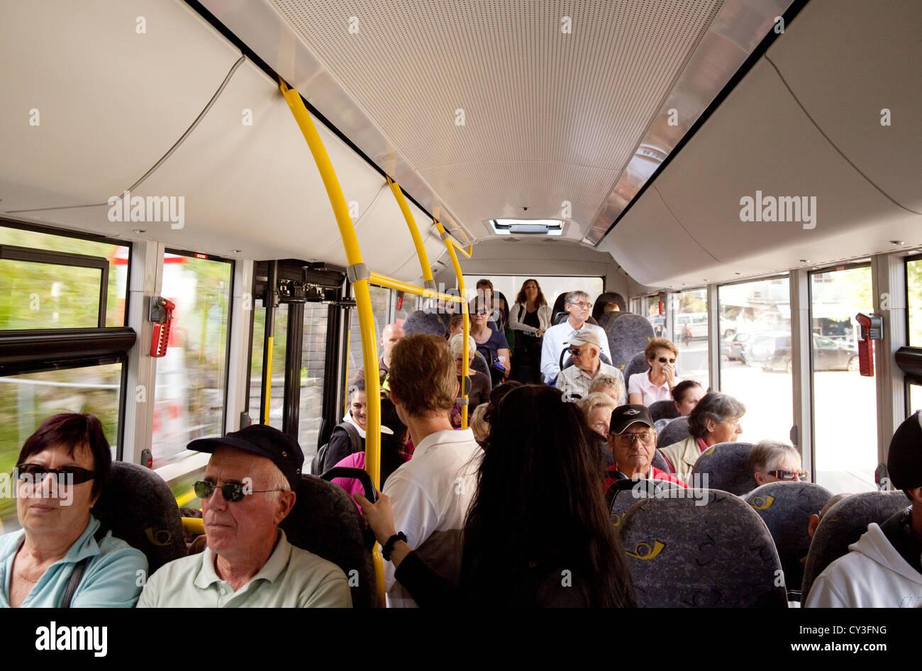A crowd inside a Swiss public transport bus, Flims, Graubunden, Switzerland Europe - Stock Image
