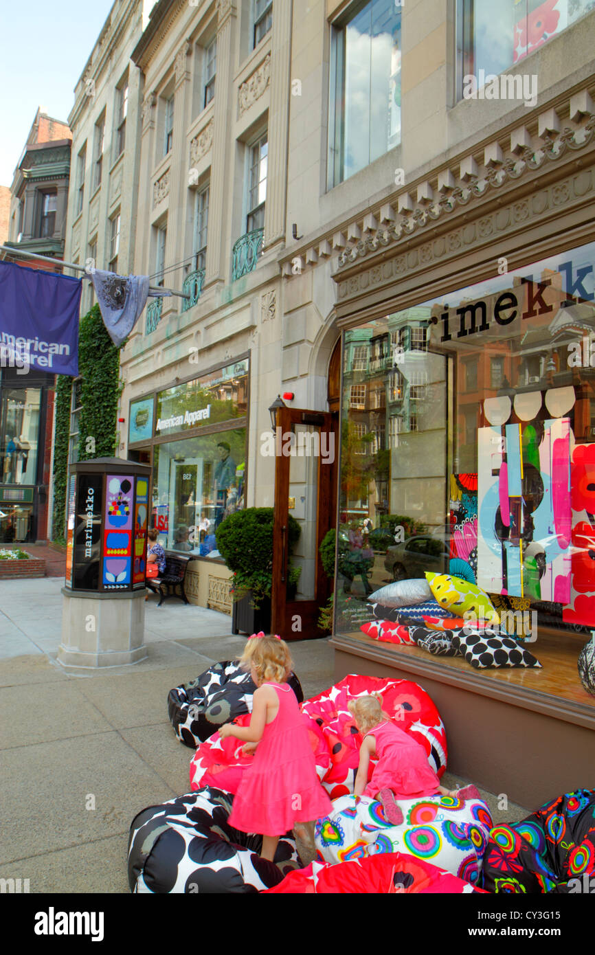 Boston Massachusetts Back Bay Newbury Street high-end luxury name-brand shopping girl playing bean bag chair Marimekko - Stock Image