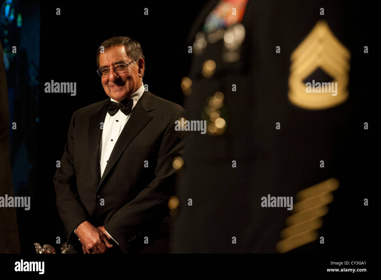 Secretary of Defense Leon Panetta watches as Army attendees are recognized by the Business Executives for National - Stock Image