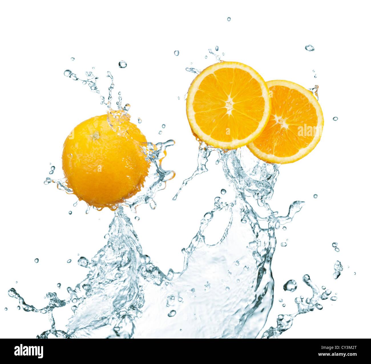 fresh oranges with water splash on white background - Stock Image
