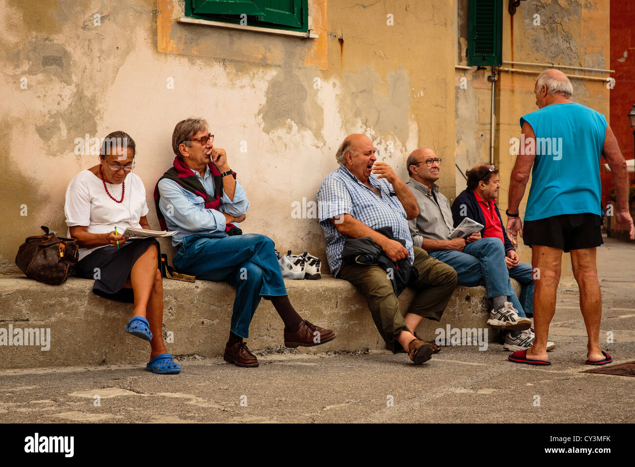 Elderly people relaxing in Camogli, Italy - Stock Image