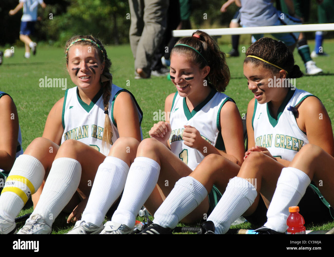 Teen soccer players on the bench waiting to play in Crownsville, Maryland - Stock Image
