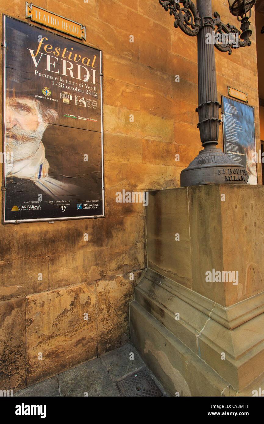 Poster in front of Teatro Regio di Parma advertising Verdi events, Italy - Stock Image