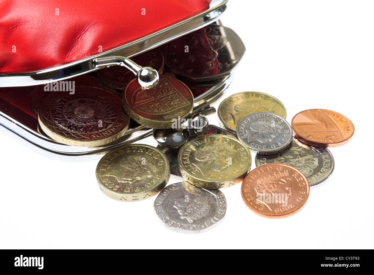 British red money purse open with some sterling coins currency spilling out on a white background from above. England - Stock Image