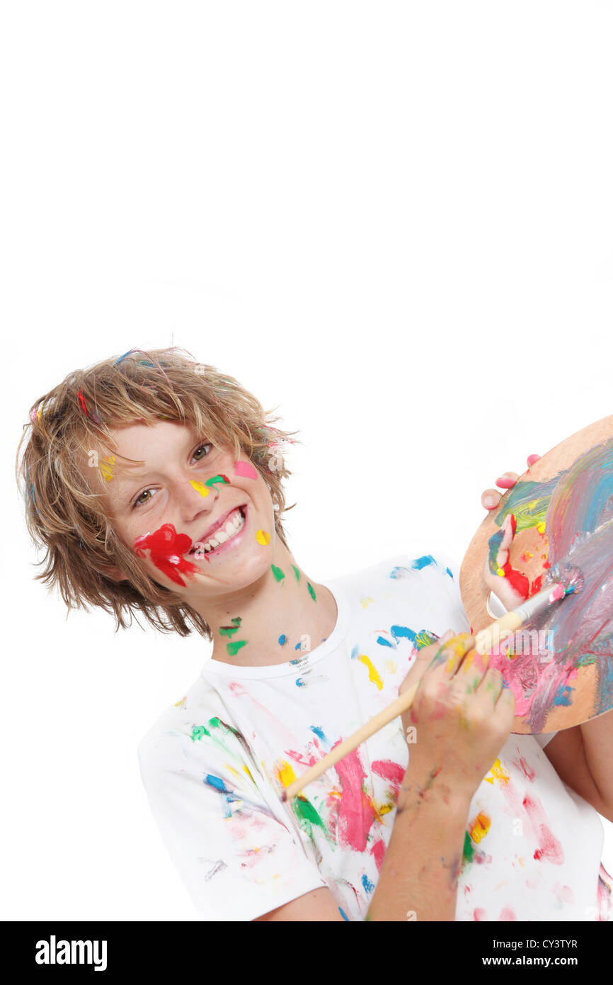 happy child or kid painting with paint and brush - Stock Image