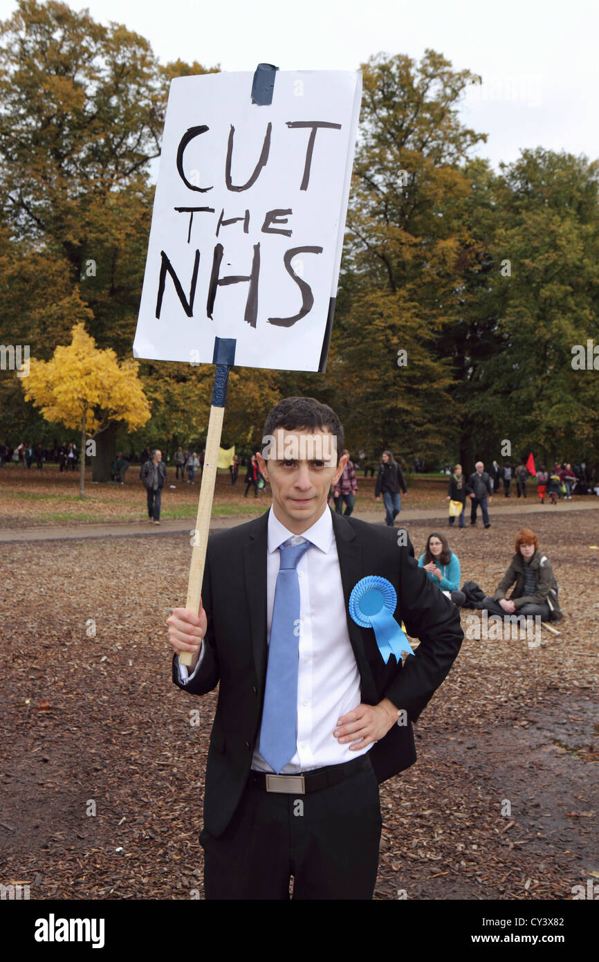 Anti government cuts protester at A Future That Works, London. Carrying placard 'Cut the NHS', London UK - Stock Image