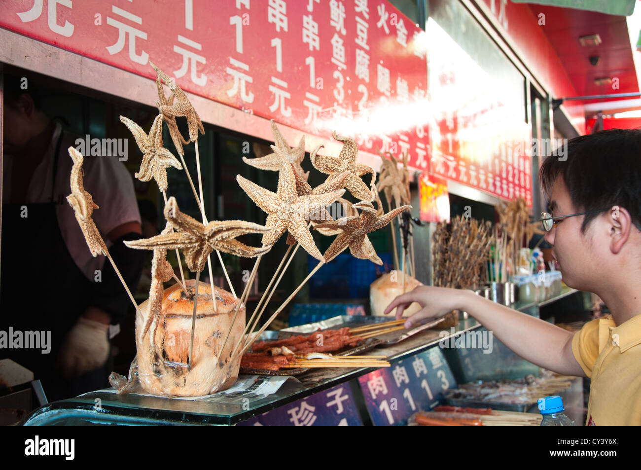 Skewered Steet Food. A popular Chinese delicacy at the DongHuaMen Night Market,  in WangFuJing, Beijing. - Stock Image