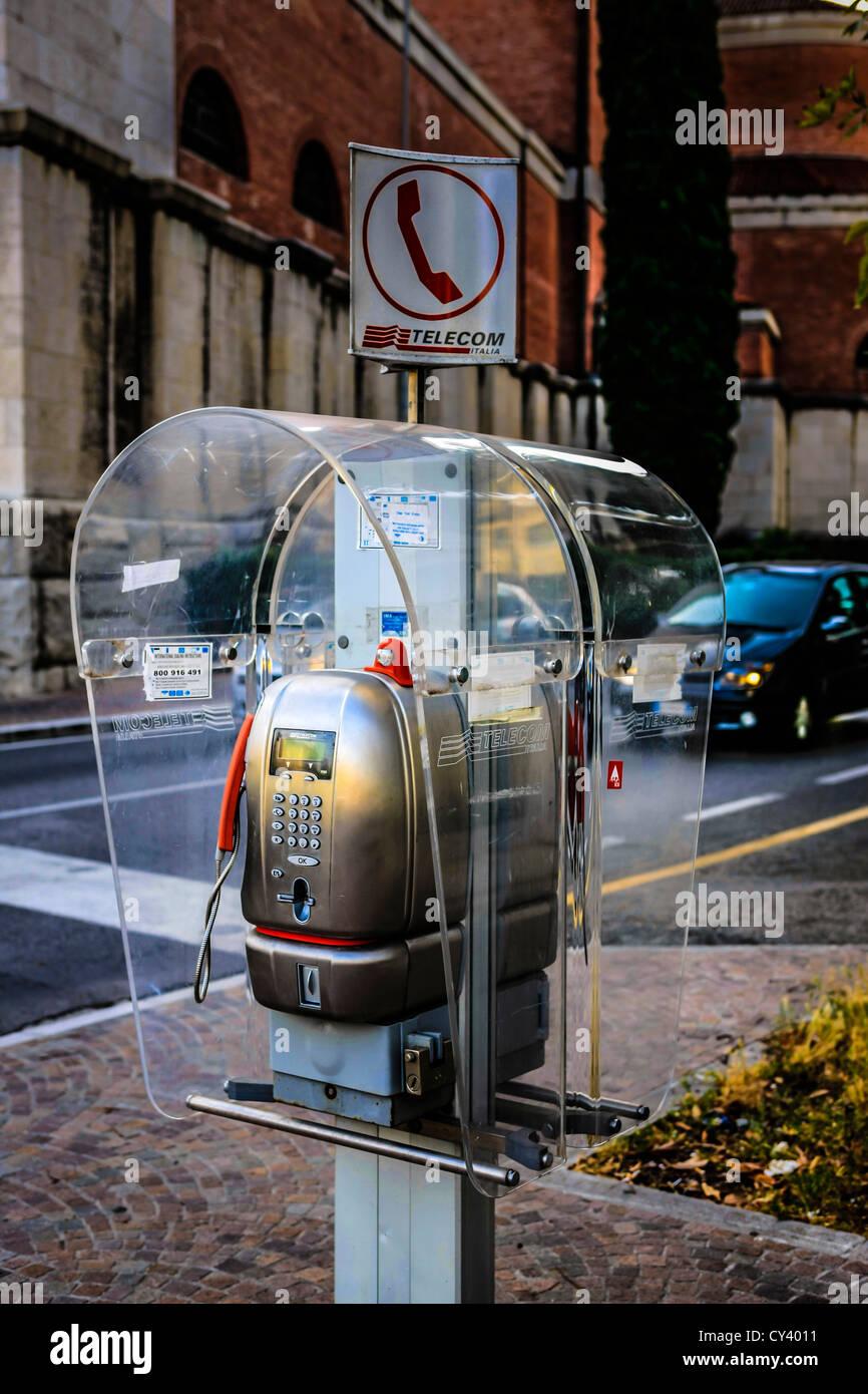 Italian public telephone kiosk in Udine Italy - Stock Image