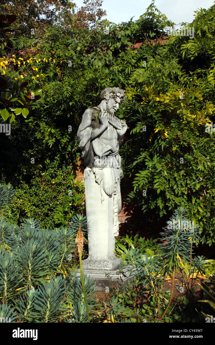 GARDEN STATUE OF GREEK GOD PAN. RHS WISLEY SURREY UK.