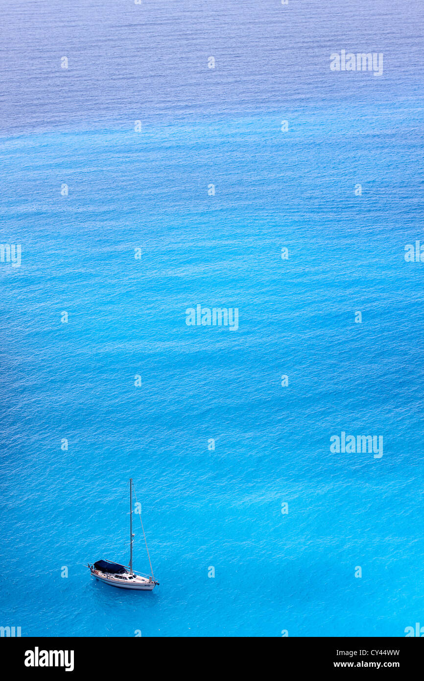 Sailing ship in the amazing cyan colored Ionian sea. - Stock Image