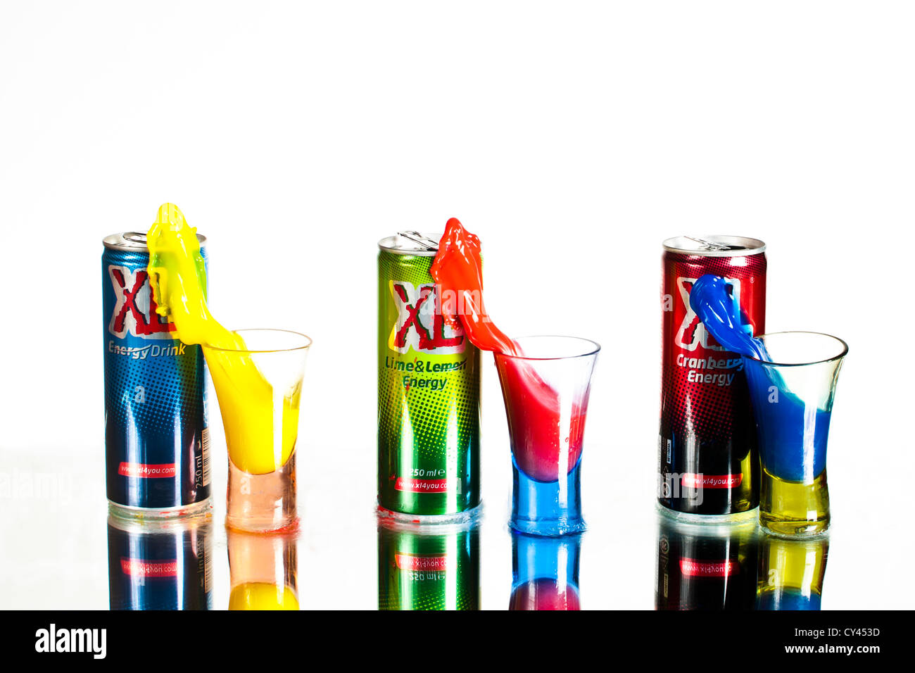 Colourful energy drinks pouring into glasses. Stop motion High-Speed photography technique - Stock Image