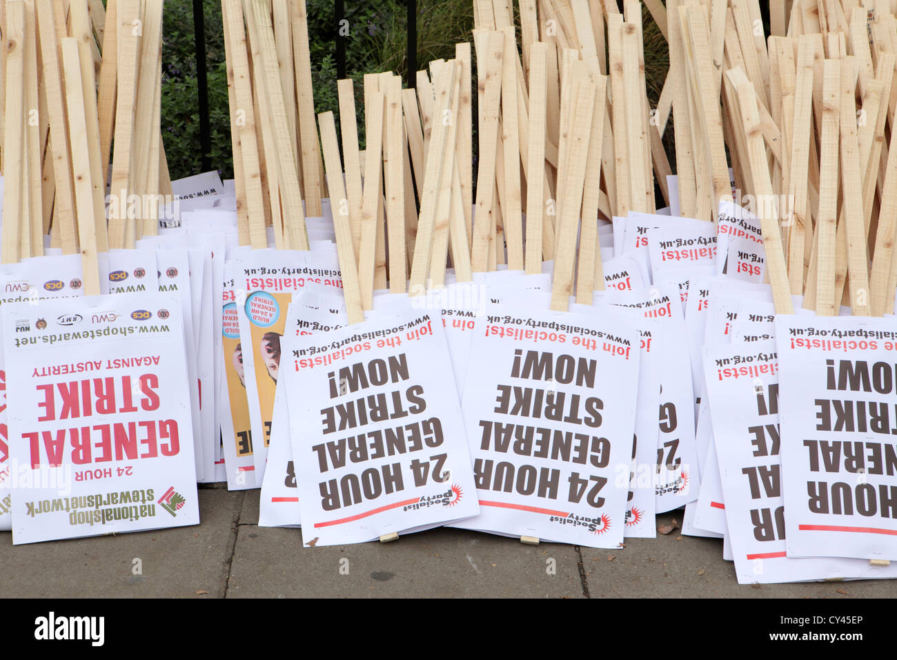 Numerous anti government cuts placards awaiting collection by protesters, A Future That Works, march & rally - Stock Image