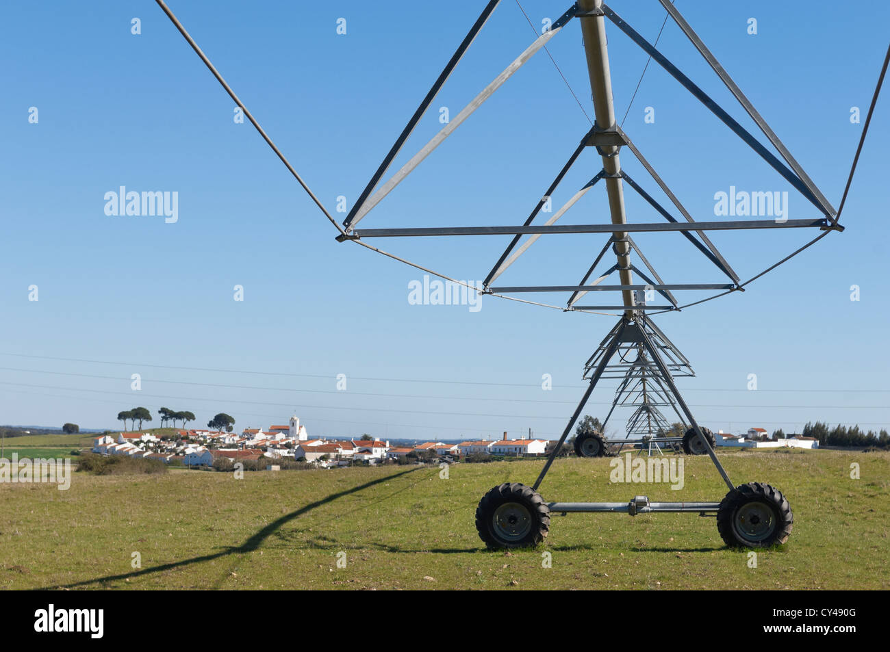 Irrigation pivot resting in a grass field of Alentejo, Portugal - Stock Image