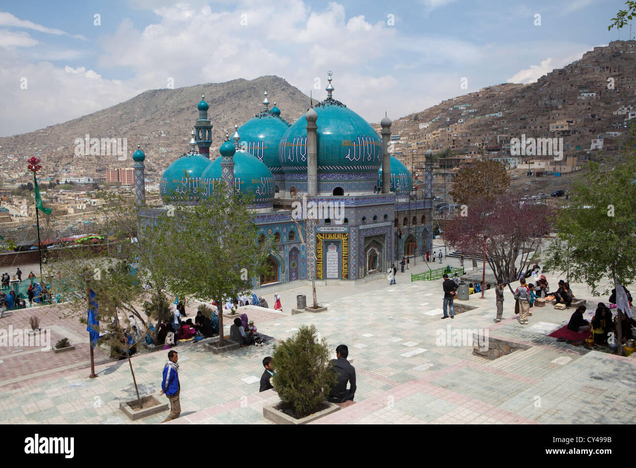 Afghan boy in front of a shia mosque in kabul - Stock Image