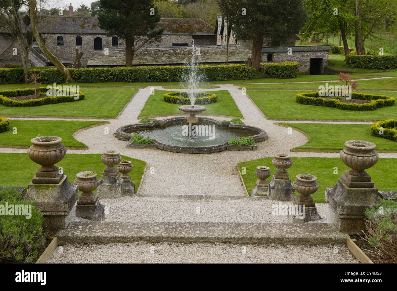 Gardens and fountain at Prideaux Place, an Elizabethan manor in north Cornwall - Stock Image