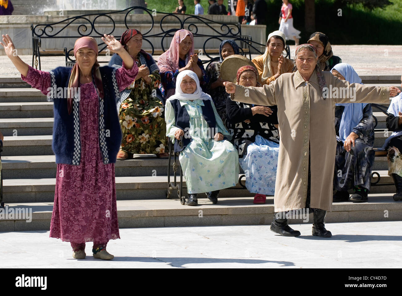 Uzbek woman having fun and dancing, Samarkand, Uzbekistan Stock Photo