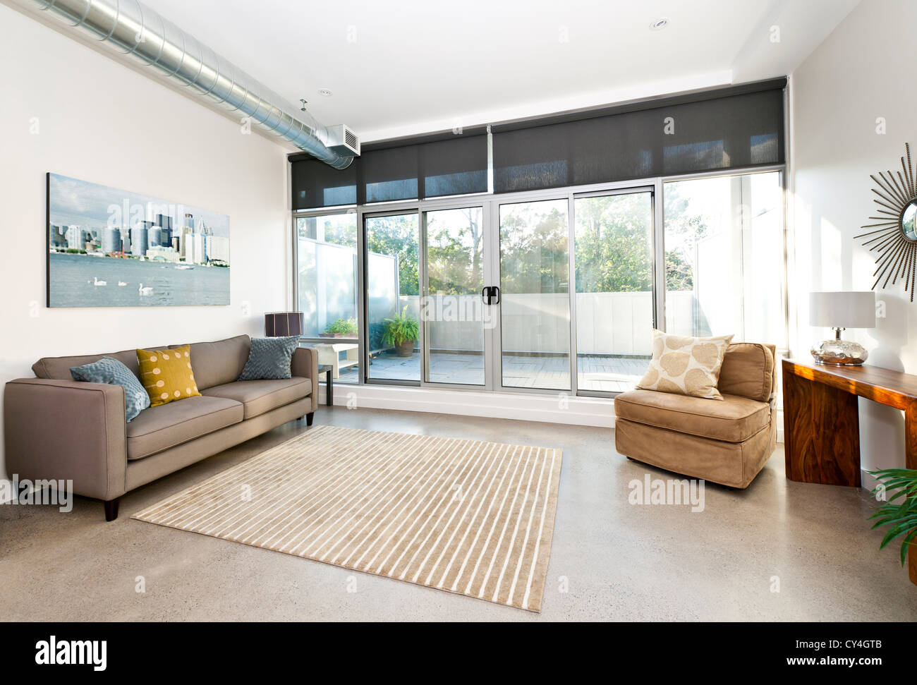 Living Room With Sliding Glass Door To Balcony Artwork From Stock Photo Alamy