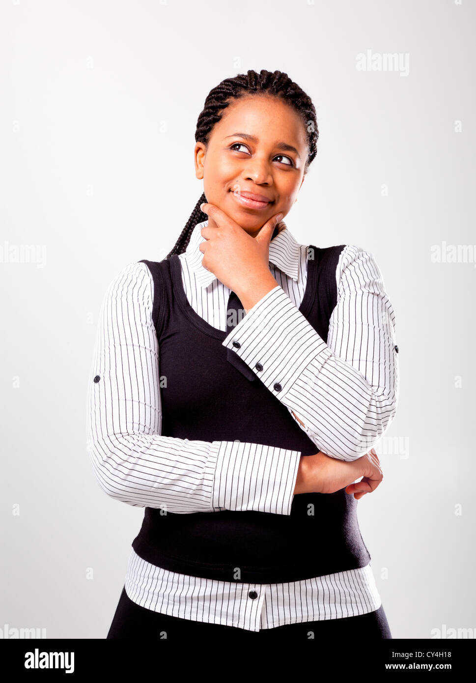 Portrait of an African woman with an inquisitive manner on an isolated background - Stock Image