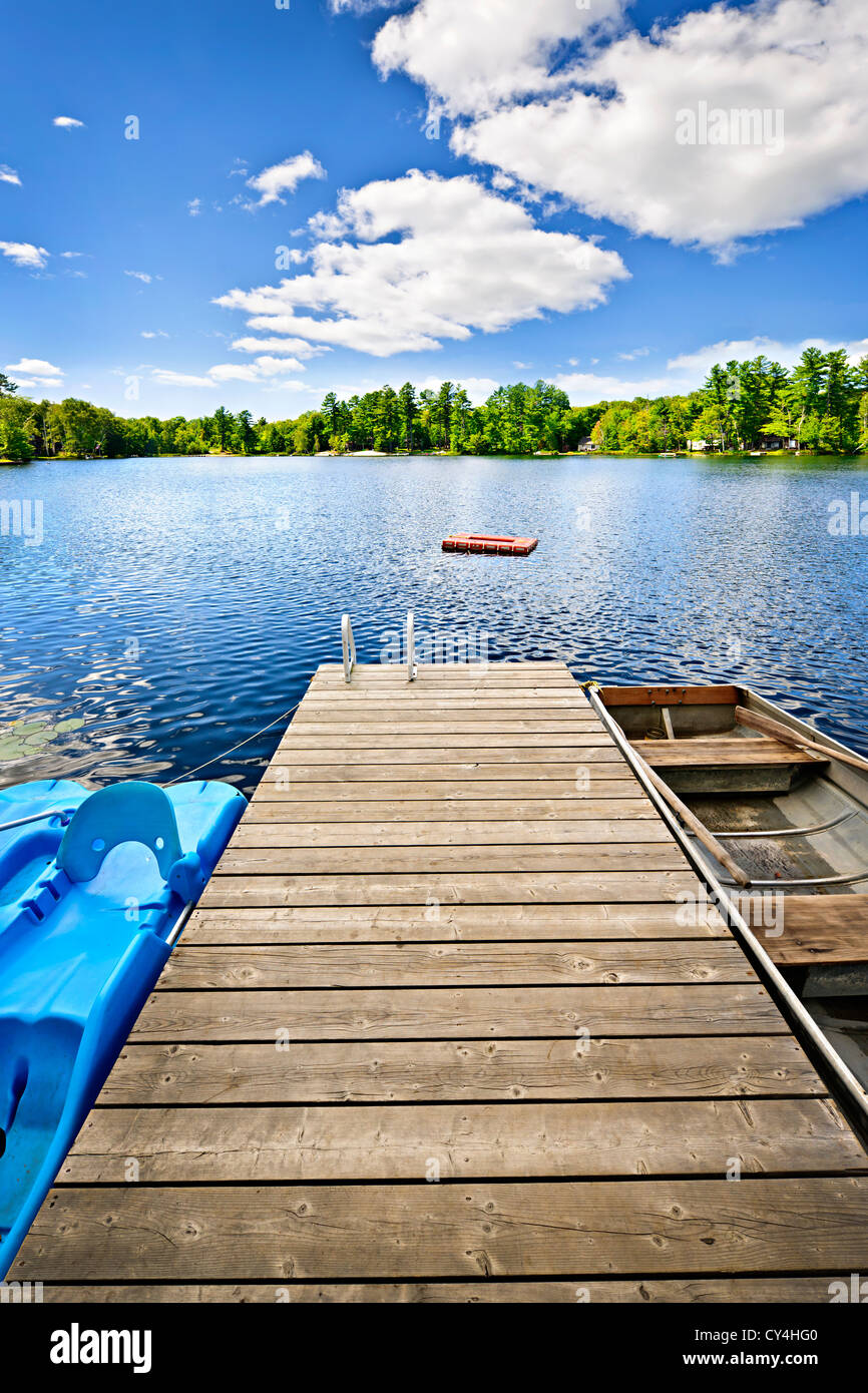 Wooden dock on beautiful summer lake in Ontario Canada - Stock Image