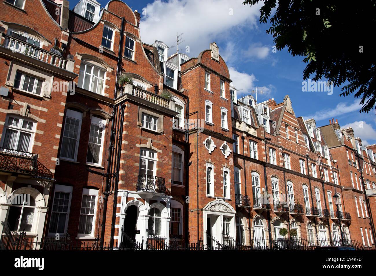 Red brick buildings in Kensington - London - Stock Image